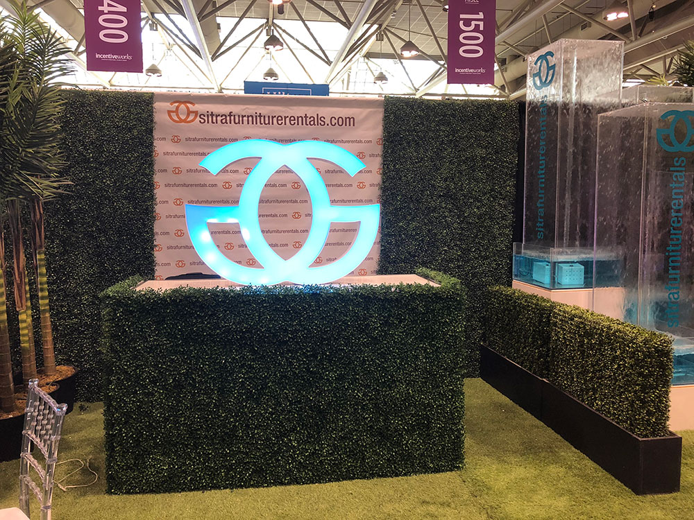 Trade show booth grass carpet palm water fountain