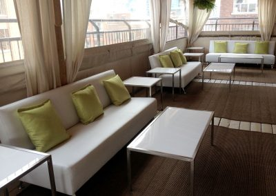 Green pillows with white furniture