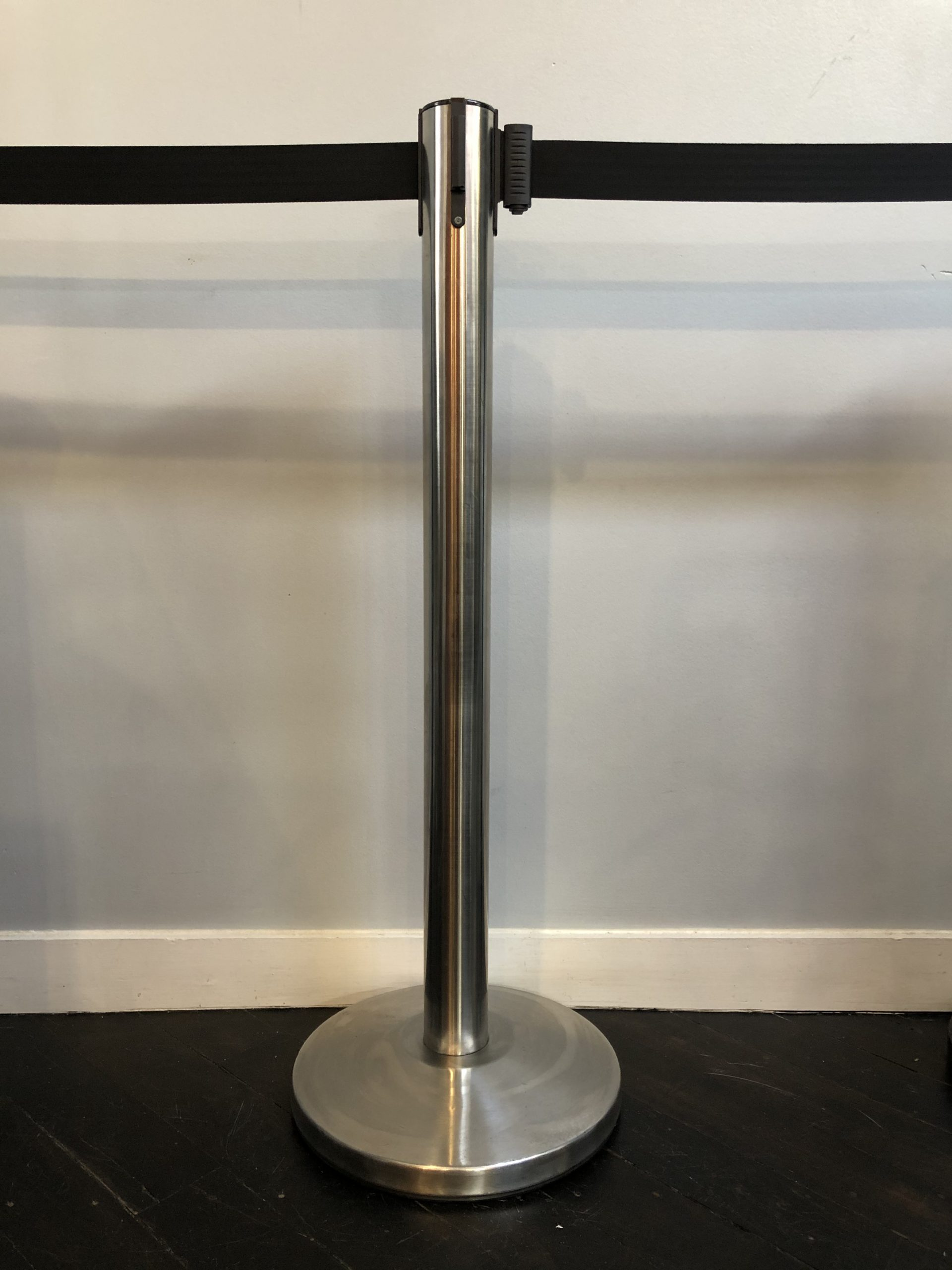Stainless stanchion with blue retractable belt