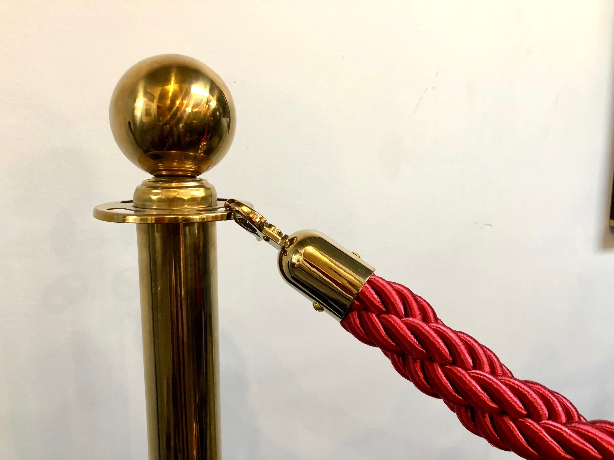 Brass stanchion with black rope