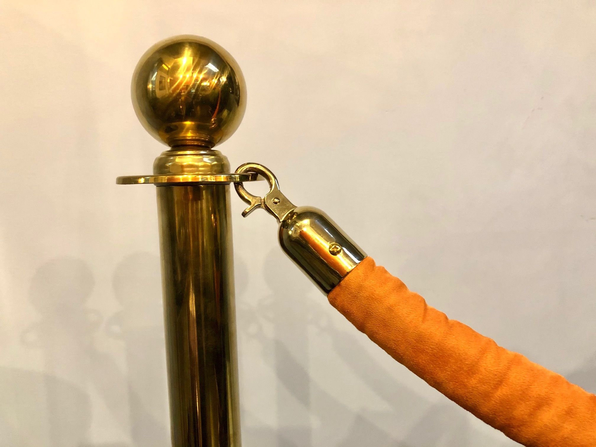 Brass Stanchions with Orange Velvet Rope